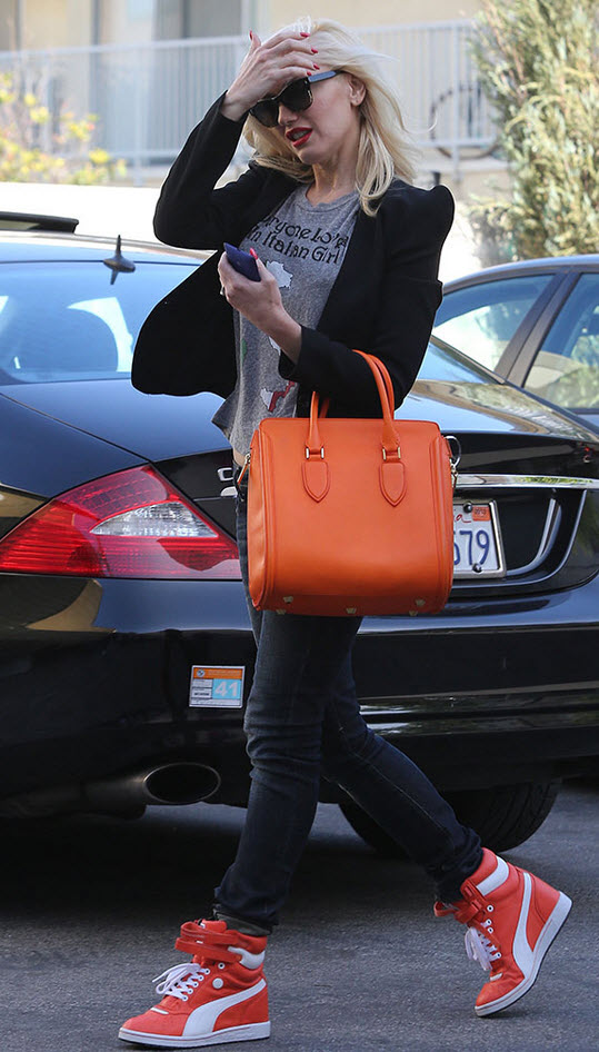Gwen Stefani in Orange Wedge Sneakers