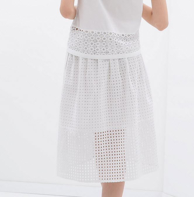 If short is not your style try this midi length cut out skirt $50 by Zara.com