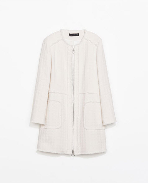 Inspired by Chanel's lux fabrics no one will be the wiser when you slip on this coat by Zara.com $159