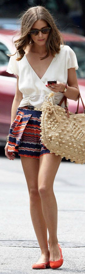 olivia palermo in a peplum top and printed shorts