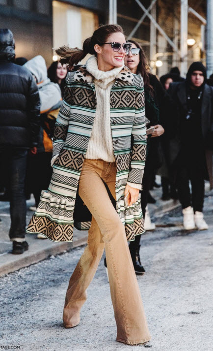Olivia Palermo in Patterned Coat, Flared brown trousers and turtleneck