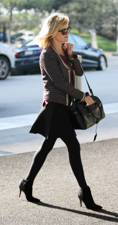 Reese Witherspoon in short black skirt, tights with black booties