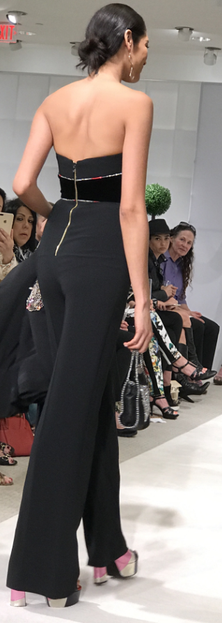 Black jumpsuit with Stella McCartney Bag